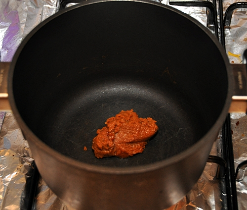 Once the meat is cooked and the paste has became aromatic, pour in the ...